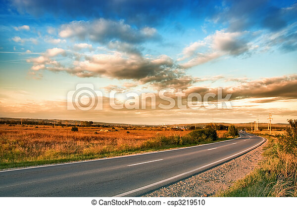 Rural road and blue sky with clouds - csp3219510