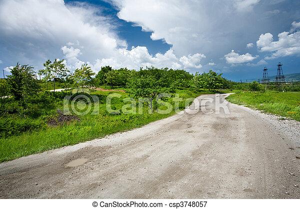 Rural road through trees - csp3748057