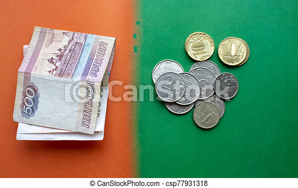 Russian banknotes and coins rubles. Background made of money. - csp77931318