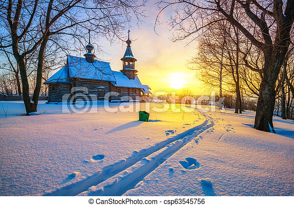 Russian church in winter forest - csp63545756
