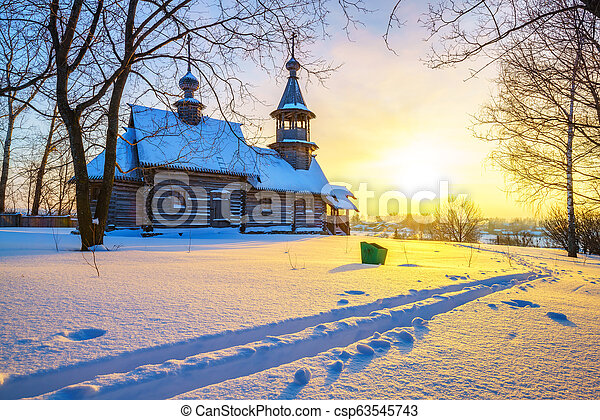 Russian church in winter forest - csp63545743