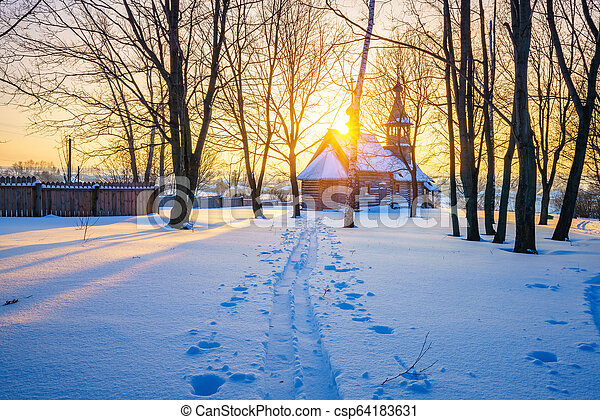 Russian church in winter forest - csp64183631