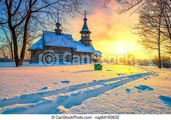 Russian church in winter forest - csp64183632