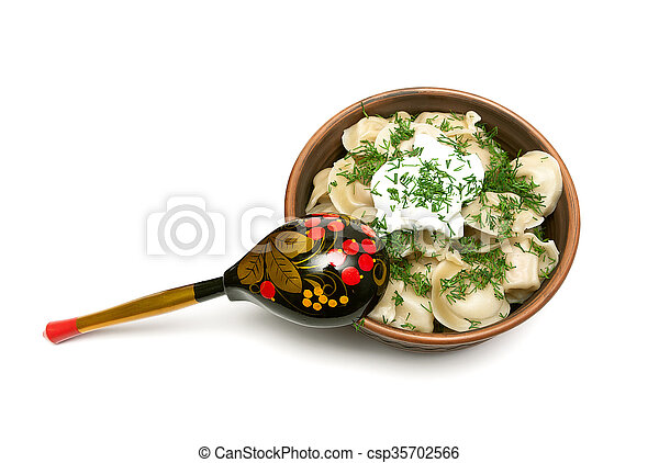 Russian dumplings with sour cream and dill. - csp35702566