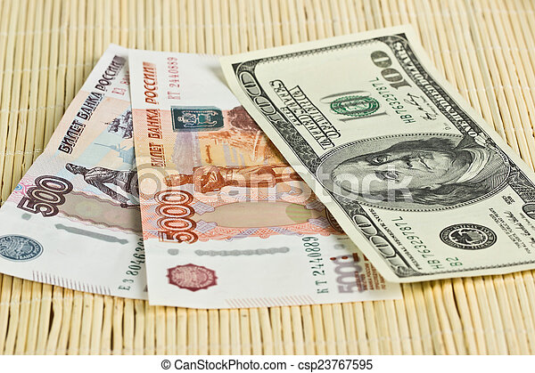 Russian rubles and US dollars on background napkins - csp23767595