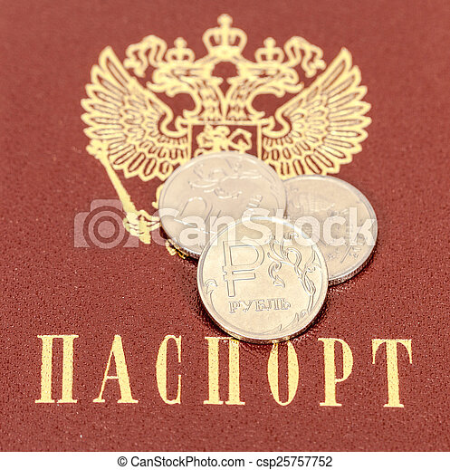 Russian rubles coins against the background of the Russian passp - csp25757752