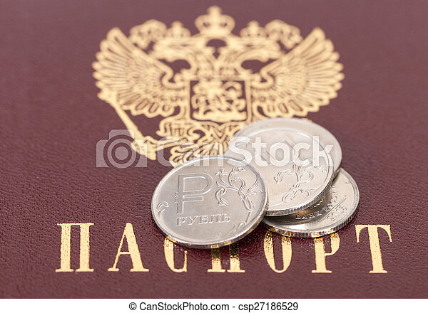Russian rubles coins against the background of the Russian passport - csp27186529