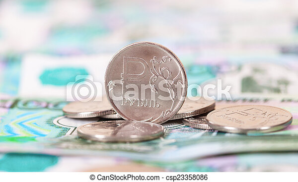 Russian rubles coins and banknotes close up - csp23358086