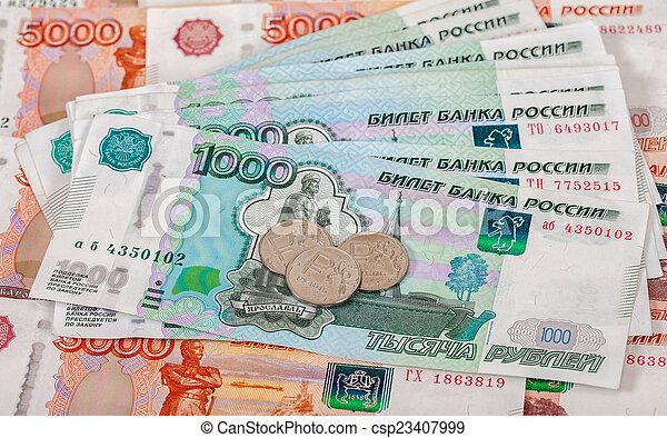 Russian rubles coins and banknotes close up - csp23407999