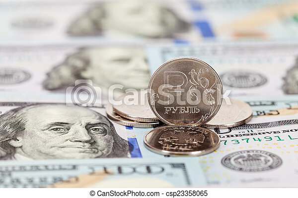 Russian rubles coins and dollars banknotes close up - csp23358065
