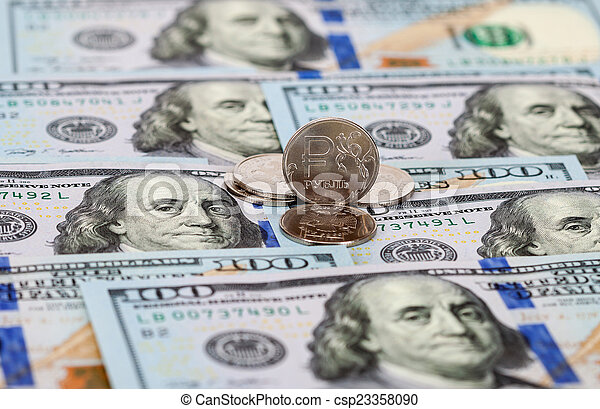 Russian rubles coins and dollars banknotes close up - csp23358090