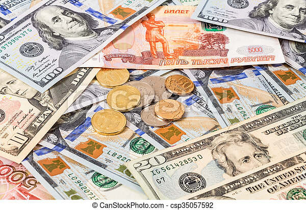Russian rubles coins over dollars banknotes close up - csp35057592