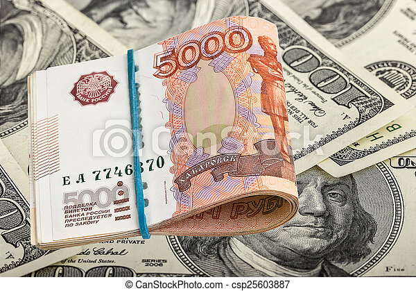 Russian rubles on dollars background - csp25603887