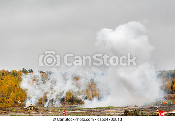 Russian tank T-90 hides in smoke screen from enemy - csp24702013