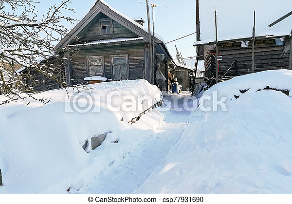 Russian village in winter, in the snow. - csp77931690