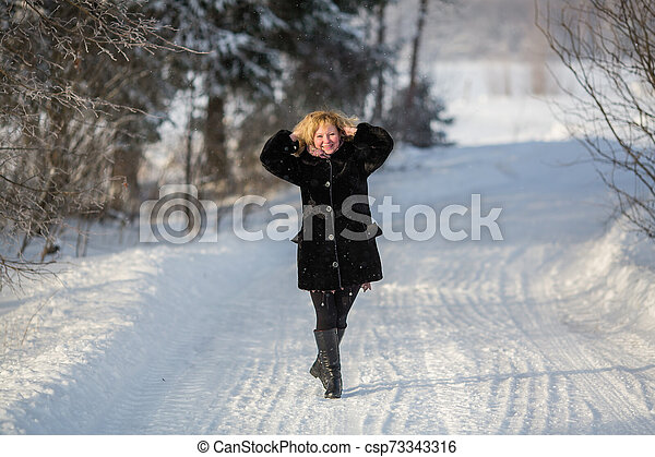 Russian woman in the winter at snowy street at village. - csp73343316