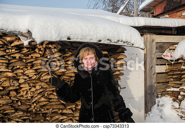 Russian woman in the winter at village. - csp73343313