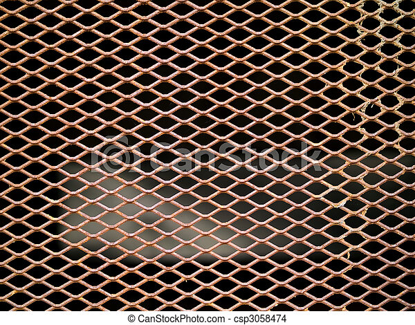 Rusted metal grate securing a tunnel hole - csp3058474