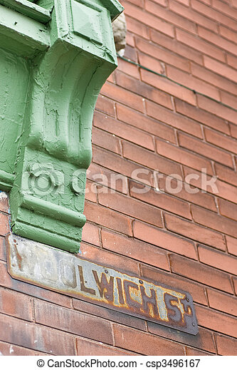 Rusted street sign on red brick wall - csp3496167