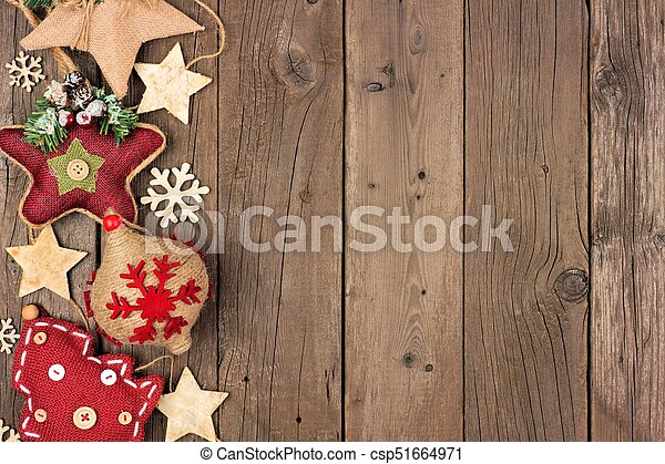 rustic christmas side border with burlap and cloth ornaments over an aged wood background csp51664971 - Rustic Christmas Background