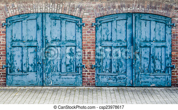 Rustic heavy wooden doors. A pair of heavy old doors on an ...
