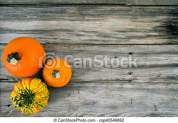 rustic pumpkin on wood high angle view - csp40546692