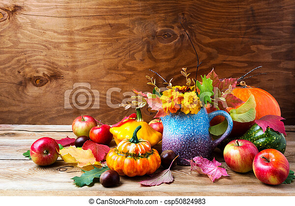 Rustic Thanksgiving Arrangement With Pumpkins And Tagetes Flowers
