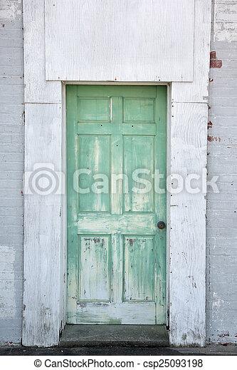 Rustic warehouse green door - csp25093198 & Rustic warehouse green door. Rustic warehouse door painted green ...