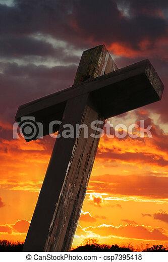 Rustic Wooden Cross Against Sunset - csp7395418