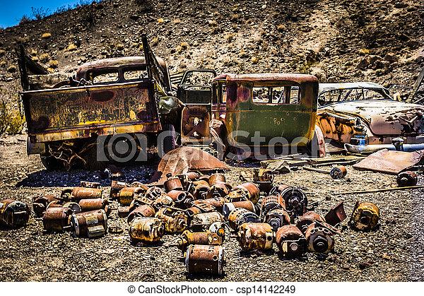 Rusty Automobiles in the Desert - csp14142249