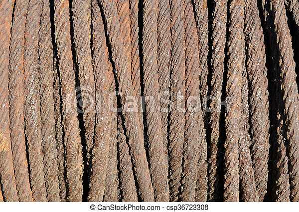 Rusty metal rope on old boat winch - csp36723308