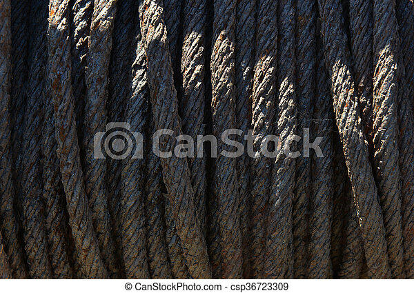 Rusty metal rope on old boat winch - csp36723309