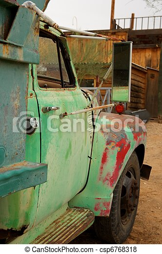 Rusty Old Truck with patches of green and red - csp6768318