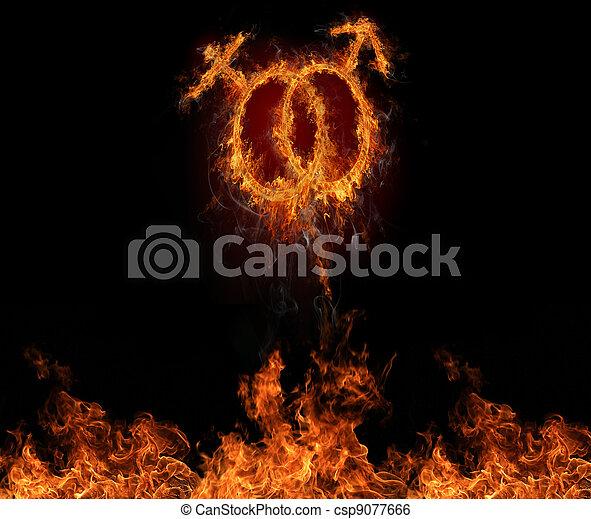 Simbolos masculinos y femeninos quemados, volando por el muro de fuego. símbolo del amor - csp9077666