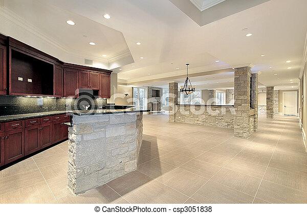 Bar de piedra y cocina en el sótano - csp3051838