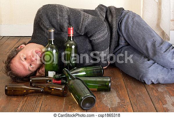 Sad And Drunk Man Drunk Man Lying On Floor With Empty Bottles