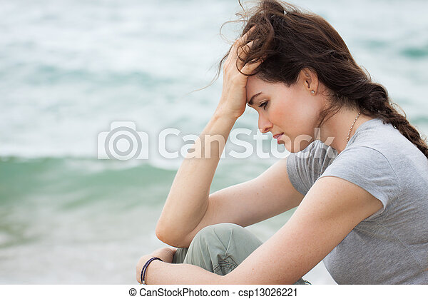 Sad and upset woman deep in thought - csp13026221