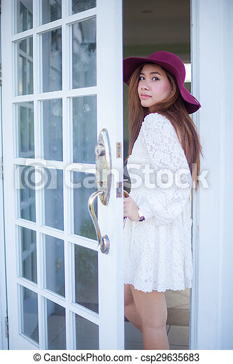 Sad Asian Vintage Woman Looking Out The Door