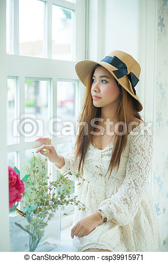Sad Asian Vintage Woman On The Window