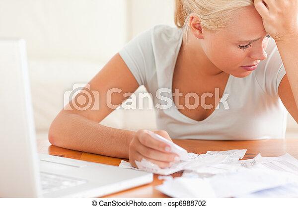 Sad blond woman accounting - csp6988702