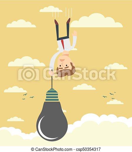 Sad businessman falling holding idea bulb as balloon . - csp50354317