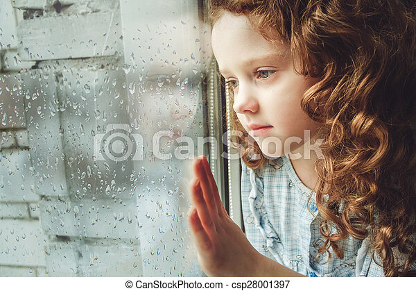 Sad child looking out the window. Toning photo. - csp28001397