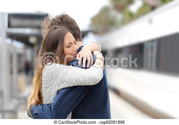 Sad couple saying goodbye before travel