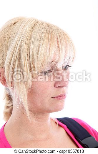 Sad despondent woman with downcast eyes - csp10557813