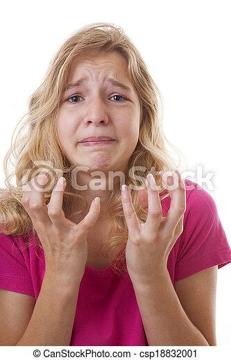 Sad girl in despair over white background - csp18832001