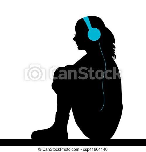 Sad girl listening music. Silhouette of sad girl listening ...