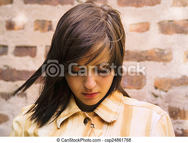 Sad girl looking down - csp24861768