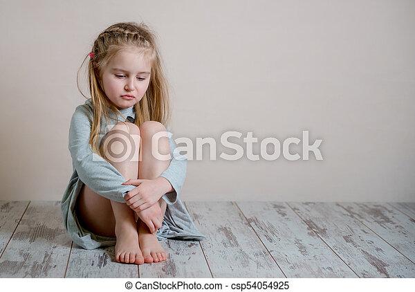 girl sitting on floor