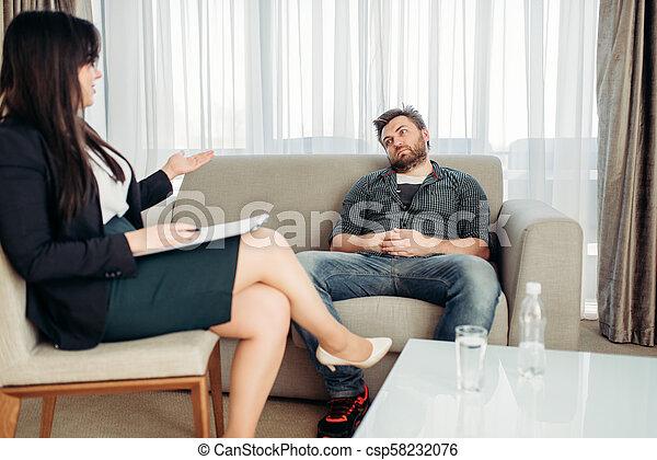 Sad hasband at psychologist, psychology support - csp58232076