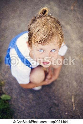 Sad little girl on the road - csp23714941